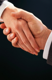 Business Handshake_-_Man_and_Woman